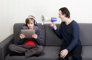 Dad shouting at son with bullhorn